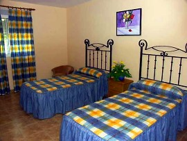 The holiday apartments: bedroom. Holiday apartments, pool, Benidorm, Costa Blanca
